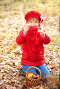 Happy smiling little girl picking mushroom mushrooms in the forest fall concept Stock Image