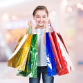 Happy  smiling little girl with shopping bags Royalty Free Stock Image
