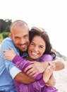 Happy smiling middle aged couple on a beach Royalty Free Stock Photo
