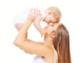 Happy smiling mother and baby having fun on white background Royalty Free Stock Photo