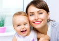 Happy smiling mother and baby kissing hugging at home Royalty Free Stock Image
