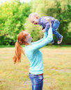 Happy smiling mother with son child having fun outdoors Royalty Free Stock Photo