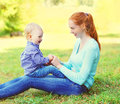 Happy smiling mother and son child having fun outdoors Royalty Free Stock Photo