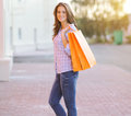 Happy smiling pretty woman with shopping bags lifestyle casual portrait Royalty Free Stock Photos
