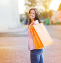 Happy smiling pretty woman with shopping bags lifestyle casual portrait Royalty Free Stock Image