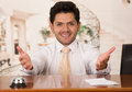 Happy smiling receptionist in hotel looking friendly for the guests Royalty Free Stock Photo