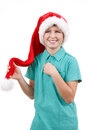 Happy smiling santa teenager weared to red claus hat isolated on white Stock Image