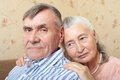 Happy smiling senior couple embracing together at home and looking the camera Royalty Free Stock Photo