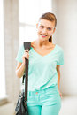 Happy smiling student girl with school bag picture of Royalty Free Stock Images