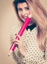Happy woman holding big oversized pencil Royalty Free Stock Photo
