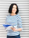 Happy and smiling teenage girl with big notepad Stock Photography