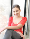 Happy and smiling teenage girl bright indoors picture of calm Royalty Free Stock Photography