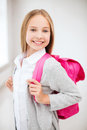 Happy and smiling teenage girl education school concept with school bag Stock Image