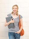 Happy and smiling teenage girl with laptop Royalty Free Stock Photography