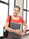 Happy and smiling teenage girl with laptop bright picture of Royalty Free Stock Photography