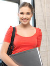 Happy and smiling teenage girl with laptop bright picture of Royalty Free Stock Image