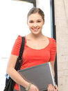 Happy and smiling teenage girl with laptop bright picture of Stock Images