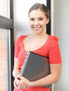 Happy and smiling teenage girl with laptop bright picture of Stock Photography