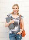 Happy and smiling teenage girl with laptop picture of Royalty Free Stock Photo