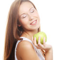 Happy smiling woman with apple isolated on white young Royalty Free Stock Images