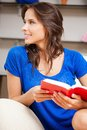 Happy and smiling woman with book bright picture of Stock Photo