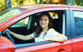 Happy smiling woman driver behind wheel red car Royalty Free Stock Photo