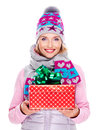 Happy smiling woman giving a christmas gift photo of adult in winter outerwear isolated on white Stock Photos