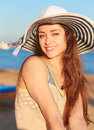 Happy smiling woman in hat on sea background closeup portrait Royalty Free Stock Images