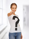 Happy and smiling woman pointing her finger Stock Photo