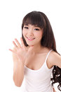 Happy, smiling woman raising, pointing her palm,  five finger up Royalty Free Stock Photo