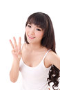 Happy, smiling woman raising, pointing her three finger up, without thumb Royalty Free Stock Photo