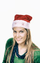 Happy smiling woman with red Christmas hat on white background Royalty Free Stock Photo