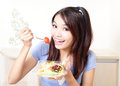 Happy smiling woman with salad at home Royalty Free Stock Photos