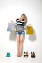 Happy smiling woman with shopping bags over white portrait of young isolated background Stock Images