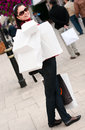 Happy smiling woman shopping with white bags Royalty Free Stock Photos