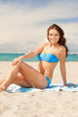 Happy smiling woman sitting on a towel picture of Royalty Free Stock Image