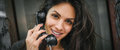 Happy and smiling woman talking in the retro phone booth Royalty Free Stock Photo