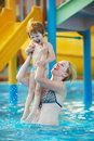 Happy smiling women child playing water park resort hotel swimming pool Stock Photo