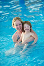 Happy smiling women child playing water park resort hotel swimming pool Royalty Free Stock Images