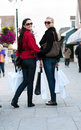 Happy smiling women shopping with white bags Royalty Free Stock Photography