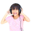 Happy smiling young asian girl in headphones isolated over white Royalty Free Stock Photo