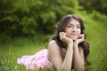 Happy smiling young bride girl dreaming on green grass at spring Royalty Free Stock Photo