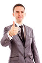 Happy smiling young business man with thumb up gesture over white background Royalty Free Stock Image