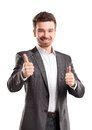 Happy smiling young business man with thumbs up gesture isolated over white background Royalty Free Stock Image