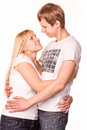 Happy smiling young couple standing together hugging Royalty Free Stock Photos