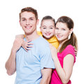 Happy Smiling Young Family Wit...