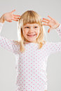 Happy smiling young girl with raised hands Royalty Free Stock Image