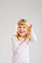 Happy smiling young girl with raised hands Stock Photo