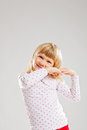 Happy smiling young girl with raised hands Stock Images