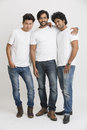 Happy smiling young male friends standing on white background Stock Images